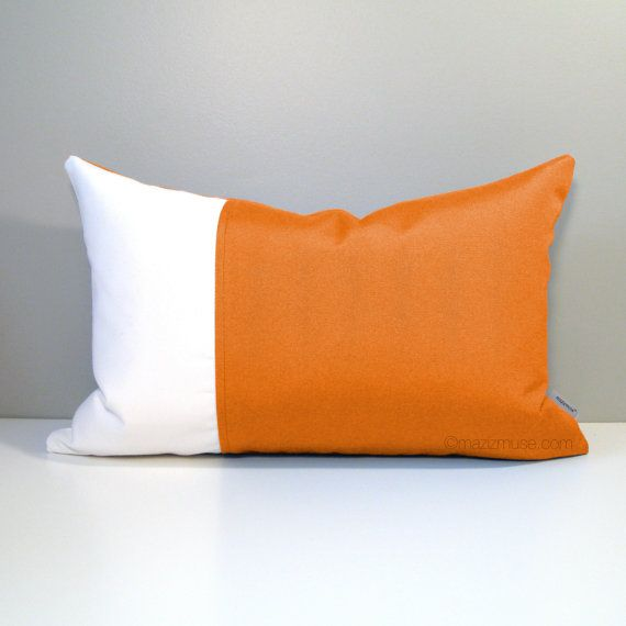 Modern Outdoor Pillow Cover in white and Tuscan orange Sunbrella fabric.  #mazizmuse #ModernPillows #OutdoorPillows