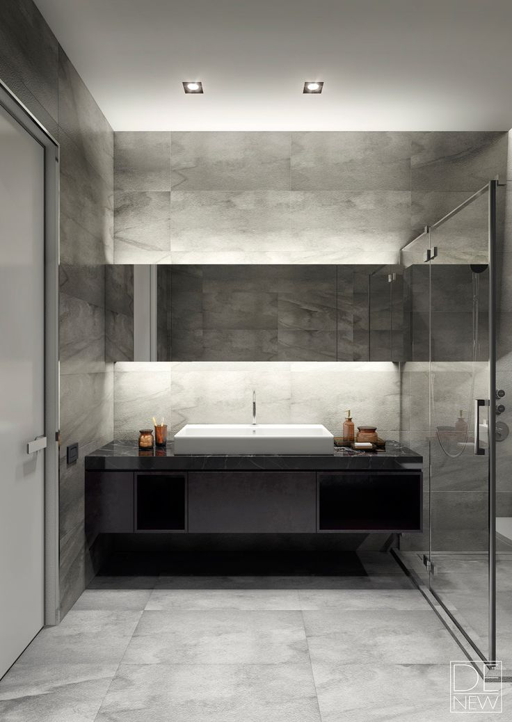 Smart indirect lighting helps the smoothly textured and monochromatic bathroom feel bright and welcoming without becoming overwhelming. It seems like a nice, relaxing place to wind down with a hot shower after a busy day.