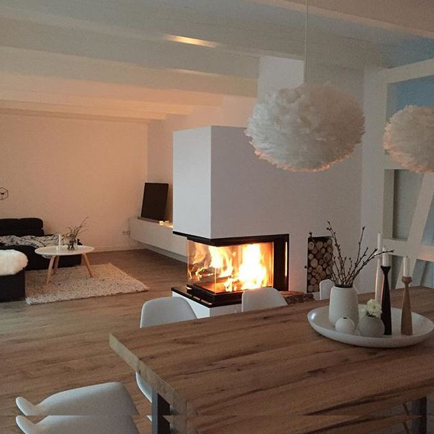 Lovely fireplace in the middle of the room.