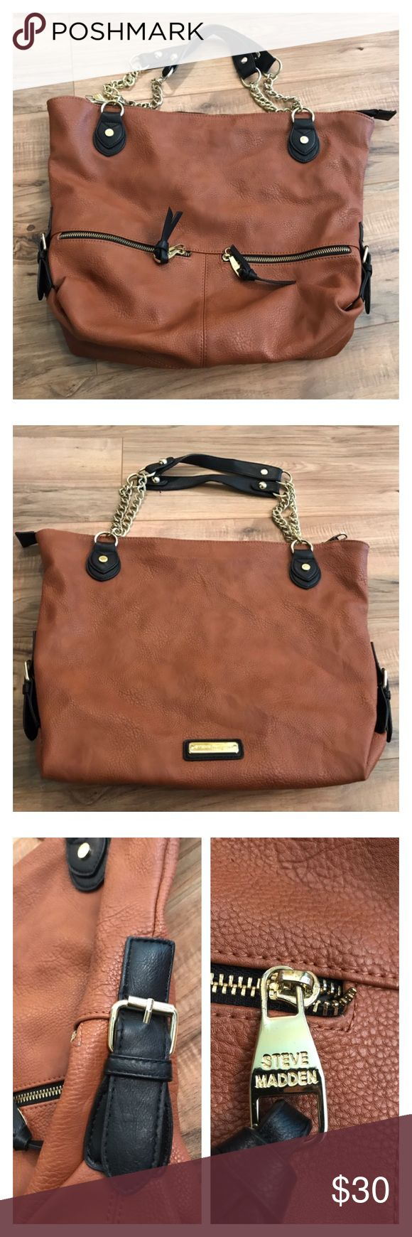 Steve Madden brown faux leather purse. Steve Madden brown faux leather purse. Front has two small zippered pockets. One of the pockets has frayed lining. Main compartment is huge. Interior lining has holes and dirt and needs cleaning. Despite the lining issues this is a great faux leather purse. Steve Madden Bags Shoulder Bags