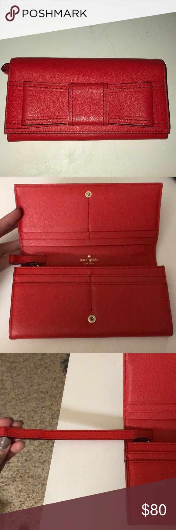 Kate Spade Wallet ❗️SALE Like new Only defect is shown in last photo Lots of card slots  Strap can be pulled to make a wristlet  Orange/Red color kate spade Bags Wallets
