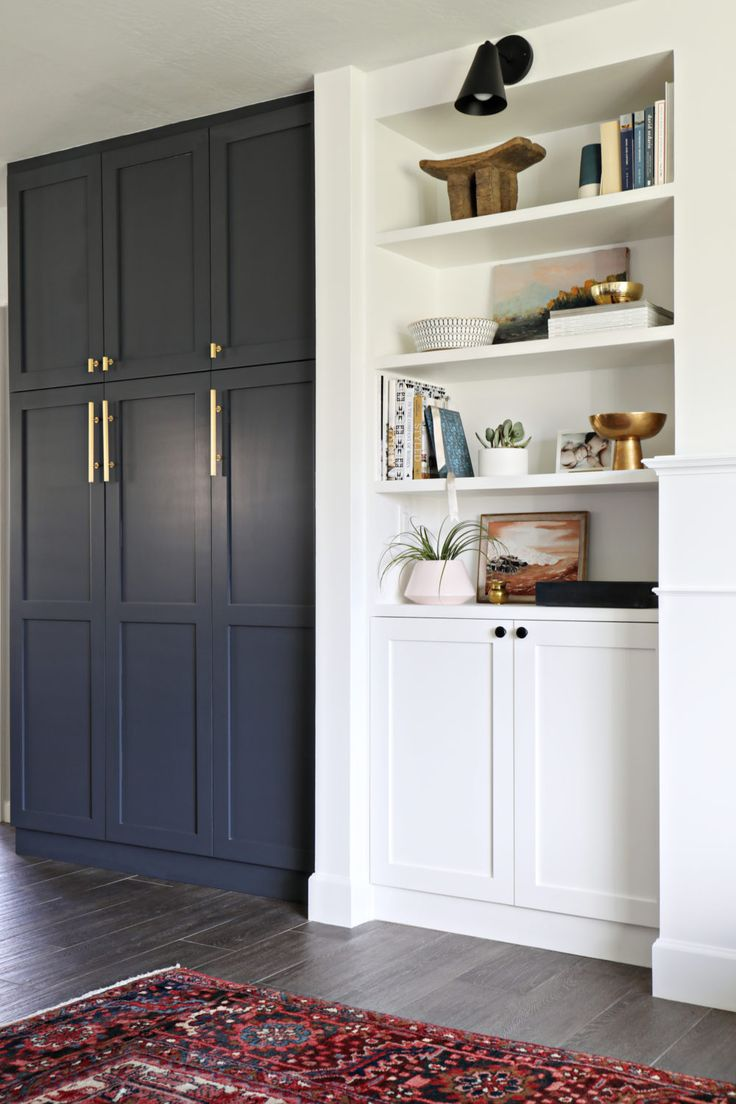And just because PAX was designed as a wardrobe, doesn't make it inappropriate for the kitchen. Brittany Makes shared her new kitchen pantry, outfitted with charcoal grey doors and brass pulls, which looks right at home next to another set of built-ins
