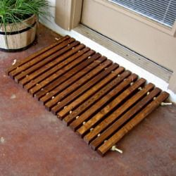 Make a simple wooden doormat using 2X2's and rope.