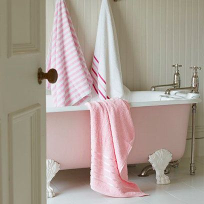 Pink bath and towels in the bathroom