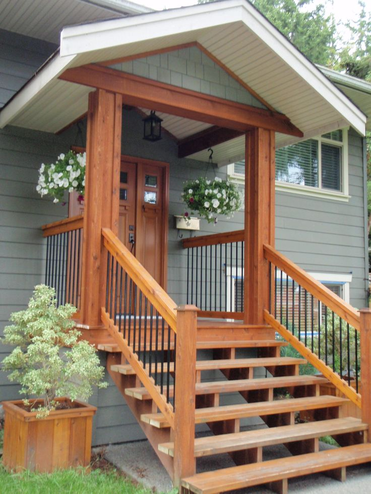 very small porch then simple wood stairs. I wonder if we could figure out a  small overhang like this on the back of our house that would look good?