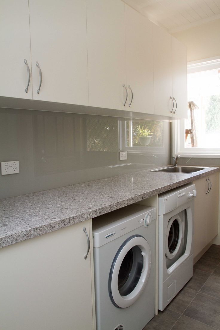 Simple, contemporary laundry. Loads of storage. www.thekitchendesigncentre.com.au