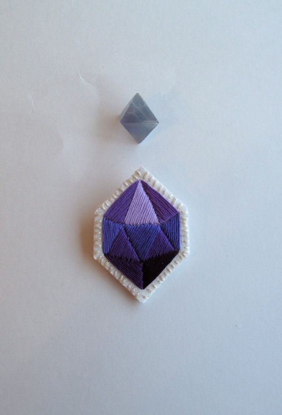 Purple geometric brooch hand embroidered faux gem on cream muslin with a cream felt back silver pin
