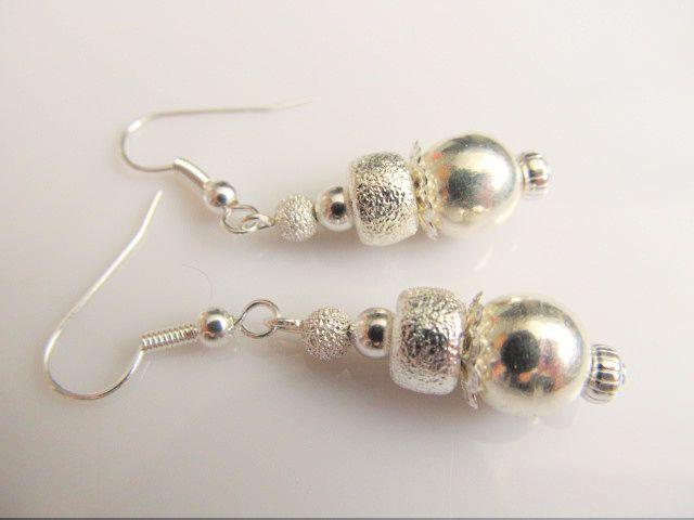 Oorbellen Silver Bling Diverse verzilverde kralen glad, brushed en glitter