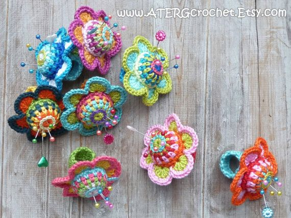 Crochet PINCUSHION FLOWER RING. Use a bottle cap for base so you dont stab through to your skin.