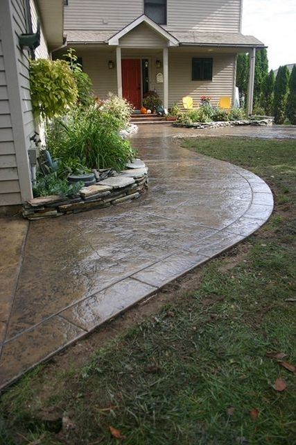 eamless stamped concrete patio and sidewalk with segmented hand tooled border - Stamped Concrete Patio Ideas