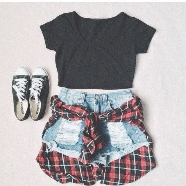 Black crop-top with high wasted shorts, black low-top converse, and a plaid flannel.