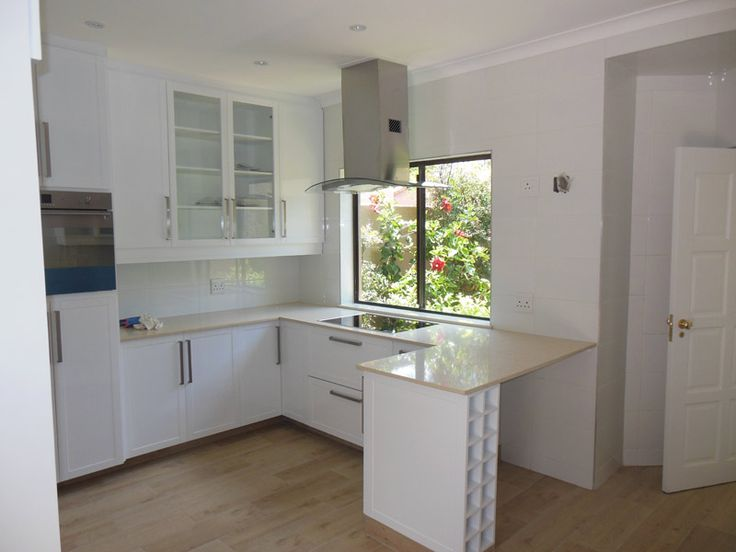 This kitchen was completely renovated. New floor and wall tiles, counters and cupboards, counter tops, electrics and plumbing, new cornices and painted ceiling.