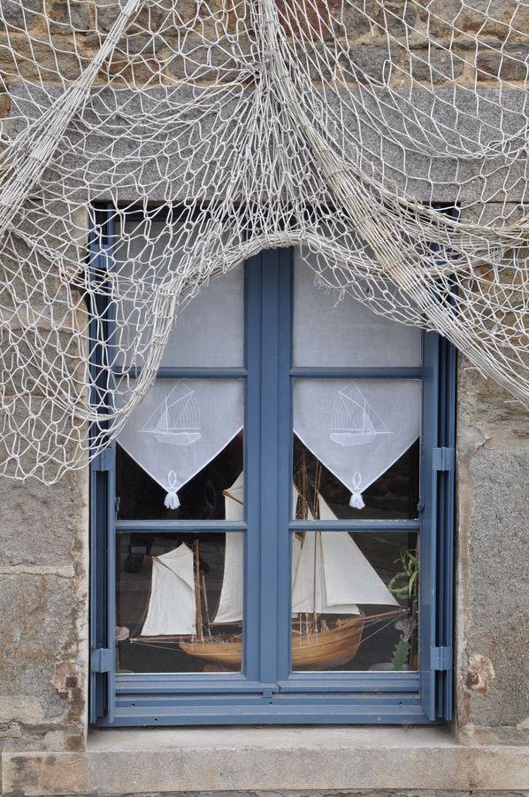 Window with ship and fishing net Saint Suliac ~ Bretagne ~ France