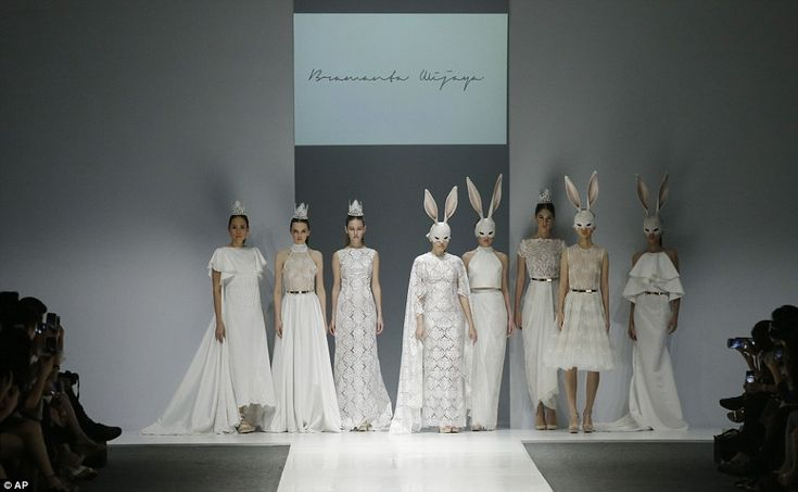 The designer has been inspired by Alice In Wonderland before and his collection with rabbi...