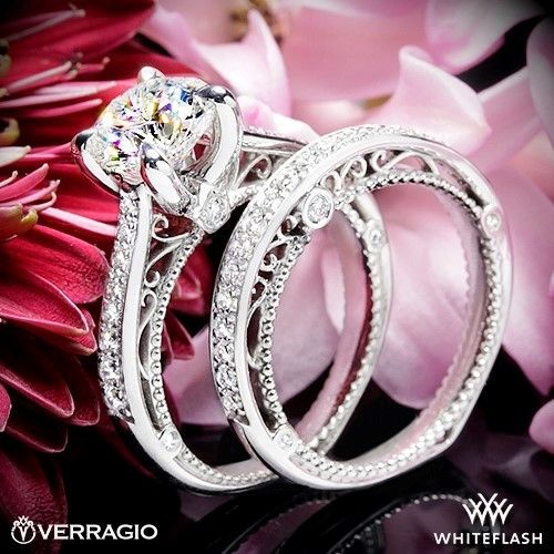 This Diamond Engagement Ring is from the Verragio Venetian Collection. It features 0.20ctw of round brilliant-cut diamonds to enhance a round diamond center.