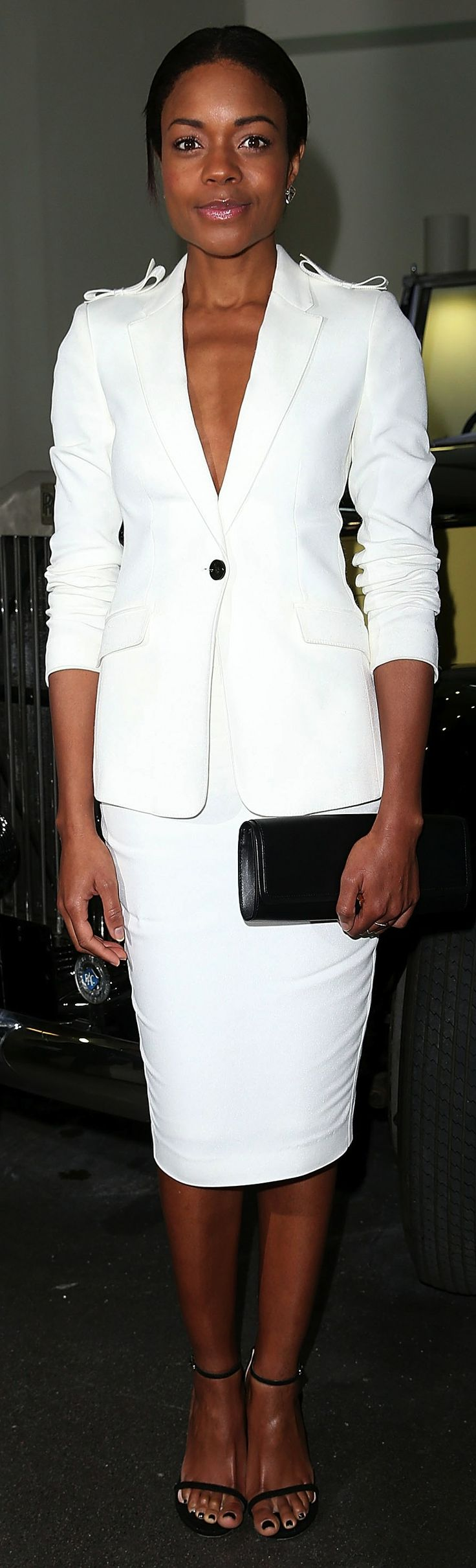 British actress Naomie Harris wearing Burberry tailoring ahead of the Bond in Motion exhibition opening in London