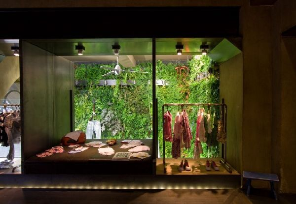natural fashion store design with vertical garden
