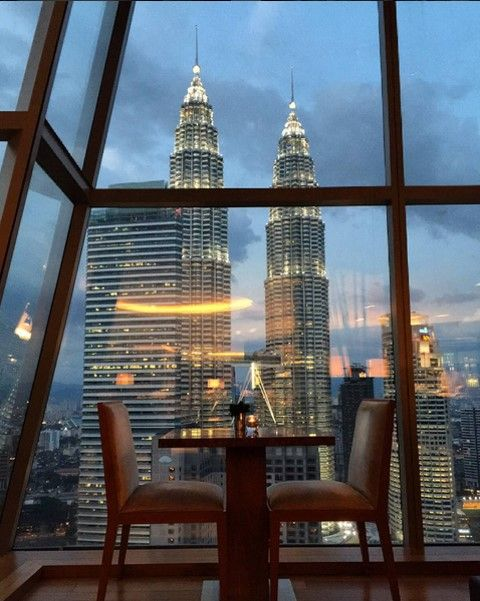 Dinner with a Grand view. 360-degree panoramas of the Kuala Lumpur skyline are a perk of dining at the famed Thirty8 restaurant at Grand Hyatt Kuala Lumpur.