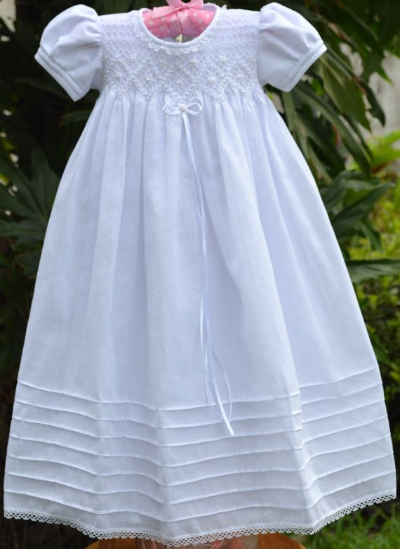 Beautiful and delicate Handmade Smocked Gown with full embroidery on bodice.    Short Sleeves with handmade embroidery detail, pin tucking on skirt