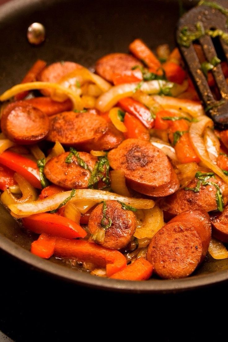 Weight Watchers smoked sausage and bell peppers! Soooo low calorie and it was nice to have something different! Ingredients: *7 oz turkey smoked sausage (about 1/2 of package, I cooked all of it at once and divided it after cooking) *1/2 cup chic...