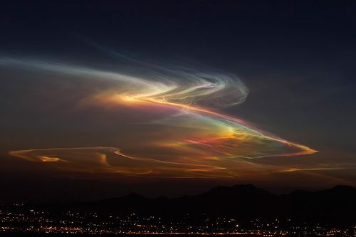 Sonora Borealis - This highly unusual cloud formation was likely formed from the exhaust of a rocket launched from Vandenberg Air Force Base in Southern California roughly an hour before this capture. The photo was taken from a mountain ridge near Tucson, AZ. (by Peaquod, via Flickr)
