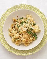 Orecchiette with Cauliflower | Martha Stewart Living - This easy pasta dinner calls for cauliflower, anchovies, and red-pepper flakes, a trio of ingredients often combined in classic Italian cooking.