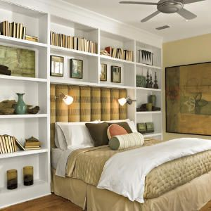 Book cases beside and above the bed. I'd add a headboard with shelves to substitute for nightstands.