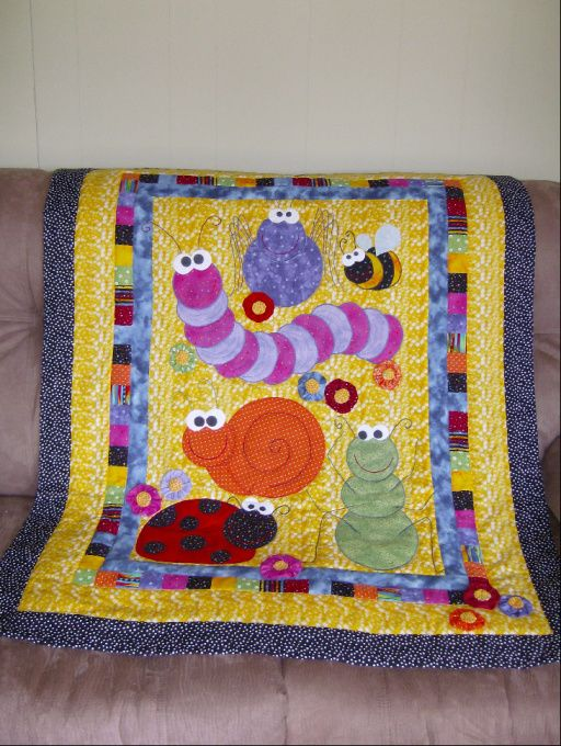 Don't Bug Me...I'm Sleeping!, This baby quilt was designed to enter in the 2007 NYS Fair...inspiration came from a brightly colored wrapping paper featuring whimsical bugs.  Quilts are judged by the public then donated to a charity after the fair.  This year's quilts are going to a local hospice.  This is the person's first quilted design... only done two small hand-tied pieced quilts., Charity Project.