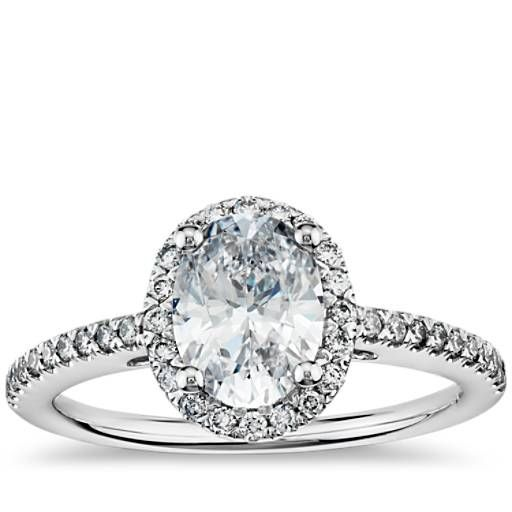 Delicate in design, this diamond engagement ring showcases micropavé-set diamonds to frame the Oval diamond of your choice set in 14k white gold.