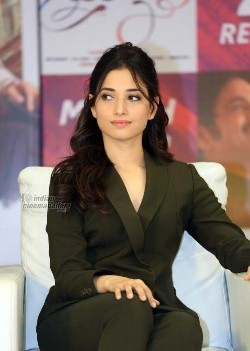Tamannaah Bhatia as the Girl Boss !!.. A Jacket Suit with no accessory and Minimal Makeup; Tamannaah Bhatia means Business here. We cannot get over this look, and its amazing how this fashion star always gets her look right... Buy similar look at https://www.estrolo.com/inspirationapp/tamanna-2/