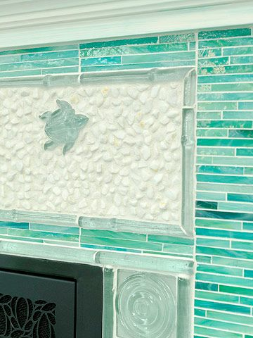 Inspired by the Sea -  I never dreamed a fireplace in my beach house, but why not?  How cozy on the cool, winter evenings.  And, I love, love, love this tile work - especially the sea turtle.