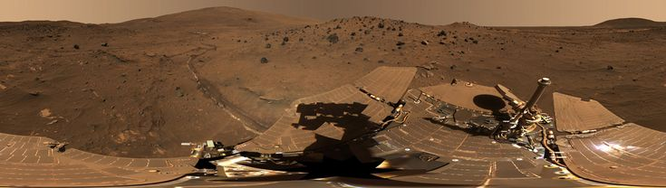 "Gusev Crater 'McMurdo' panorama taken from the Mars Spirit Rover on Martian mission days Sol 814 through 980 (April 18 to Oct 5, 2006 on Earth). Seen are volcanic rocks, Husband Hill (left), ""El Dorado"" sand dunes, and the lighter colored ""Home Plate"" below the dunes."