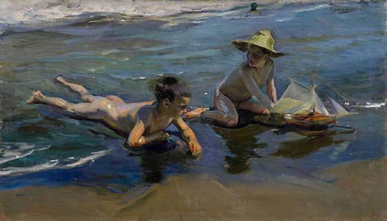 Niños en la playa con barco