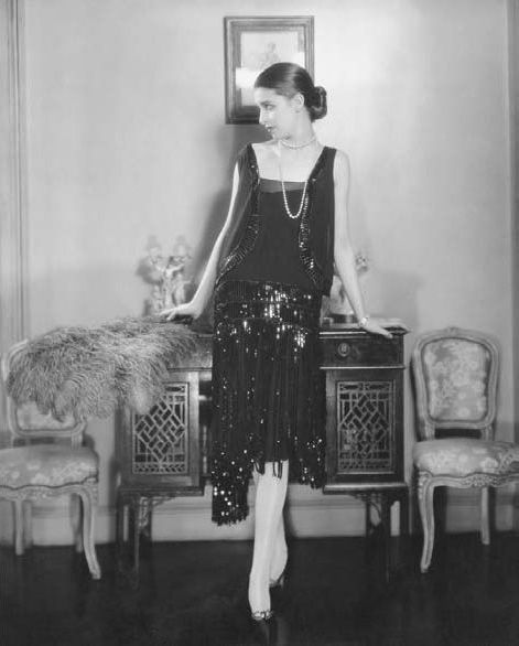 "Chanel Cocktail Black Flapper Dress in 1926.  Coco Chanel originated the concept of the ""little  black dress"" which with the addition of certain accessories could be worn for evening cocktail hours."