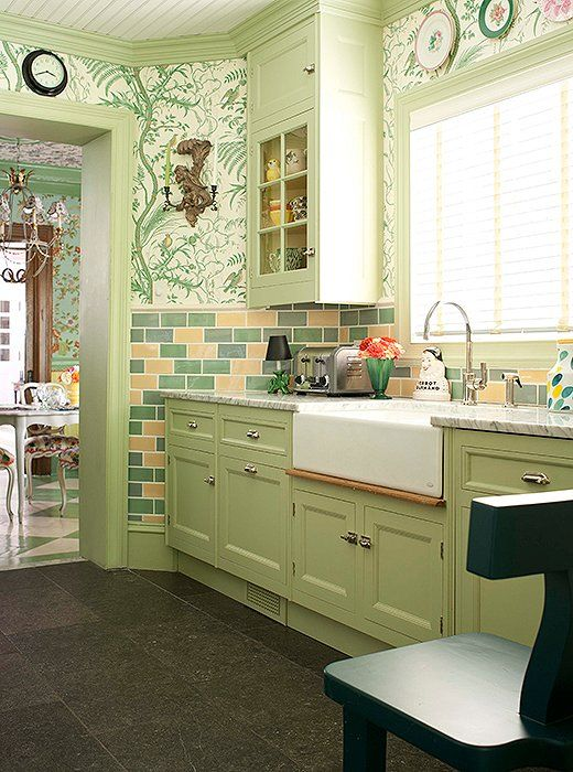 """Jason Oliver Nixon and John Loecke, the designers behind Madcap Cottage, used the vibrant shade of """"Cooking Apple Green"""" by Farrow & Ball in their former Brooklyn kitchen, resulting in a kitchen packed with personality and zest."""