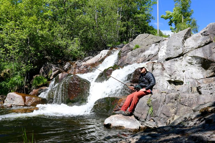 Norwegian Waterfall flyfishing. In that deep pool hides many a trout, and the view out over a turquoise fjord.
