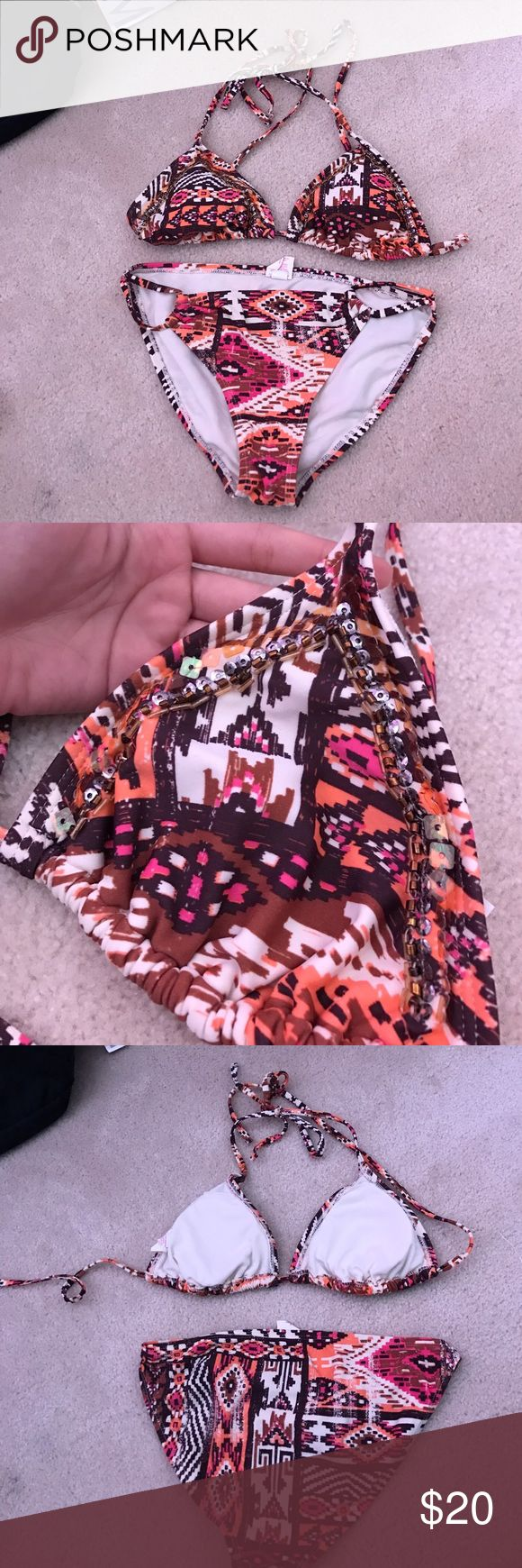 Embellished Aztec Bikini set Top is a size S, bottoms are a size M (fits like a S). Top has beaded embellishments and removable pads. Make an offer! Swim Bikinis
