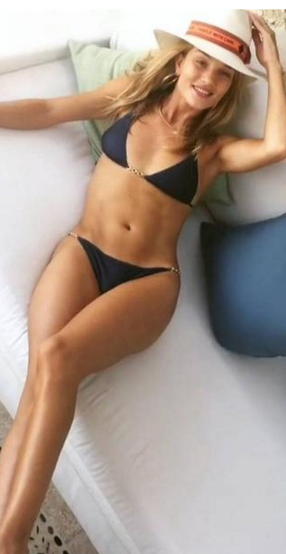 Rosie Huntington-Whiteley wearing Bikini – Elizabeth Hurley  Hat – Maison Michel