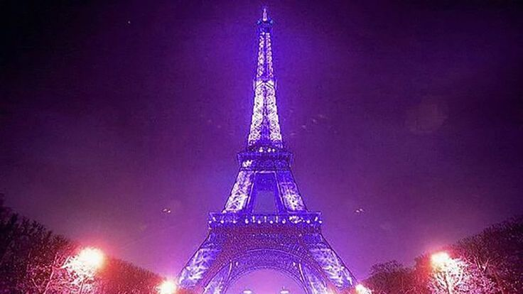 """After news of the Princes""""death on Thursday, plenty of famous monuments lit up in purple to honor him fitting for the """"Purple Rain"""" singer.  In one of the most stunning displays, the Eiffel Tower was cast in purple lights."""