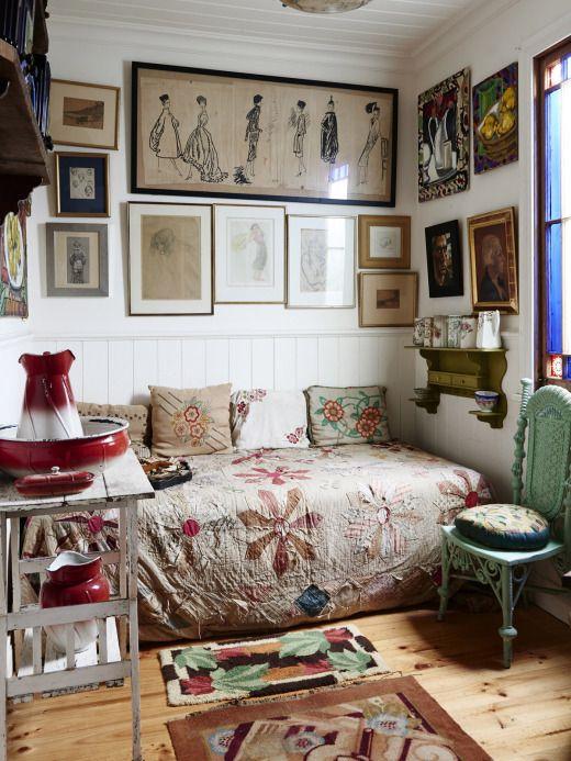 Bedroom nook, cluster wall, vintage bedside shelf.