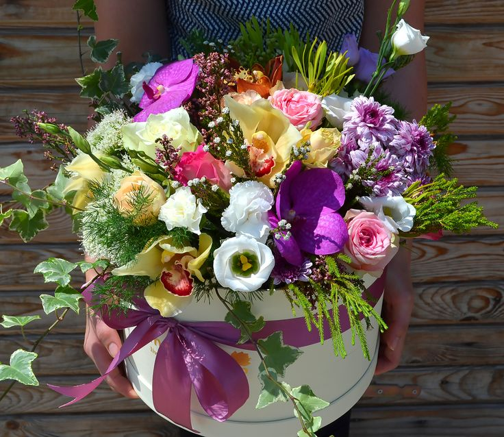 Wonderful box with flowers. Orchids, Eustoma, Roses in a flower arrangement in box