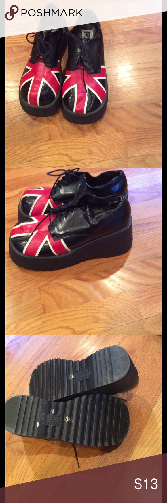 """UK black creepers Union Jack decorates these funky creepers. Platform is about 2-1/2"""". These are in used condition, with cracking starting in the pleather. Shoes Platforms"""
