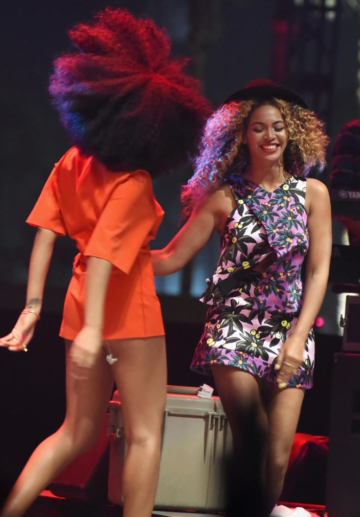 INDIO, CA - APRIL 12:  Singers Solange (L) and Beyonce perform onstage during day 2 of the 2014 Coachella Valley Music & Arts Festival a...