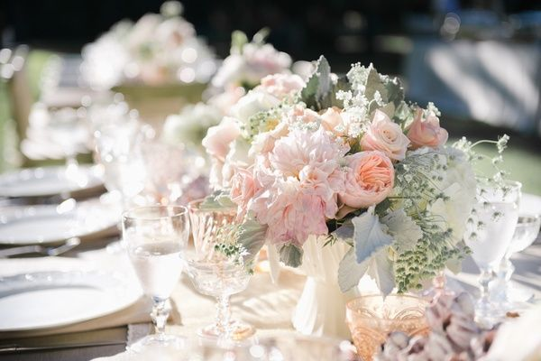Shabby Chic Centerpiece   Article: 15 Reasons to Pick Peach as One of Your Wedding Colors   Photography: Jana Williams Photography   Read More:  http://www.insideweddings.com/news/planning-design/15-reasons-to-pick-peach-as-one-of-your-wedding-colors/2052/