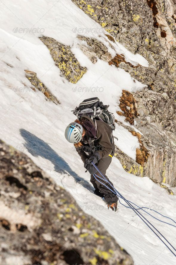 Climber while Rappelling - Stock Photo - Images