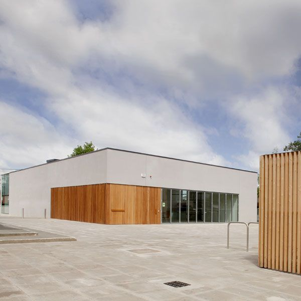 To signify that the building is open a large timber pivot door is opened leading one into a low stone lined entry space with a simple bench for one to sit and gather.