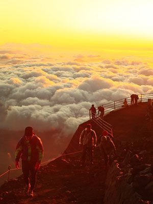 Defying my then sportsman fiance Carlos who couldn't deal with the rare oxygen to make it to the top. Nancy and I made it! - Hiking around the crater at the summit of Mt. Fuji at Sunrise.