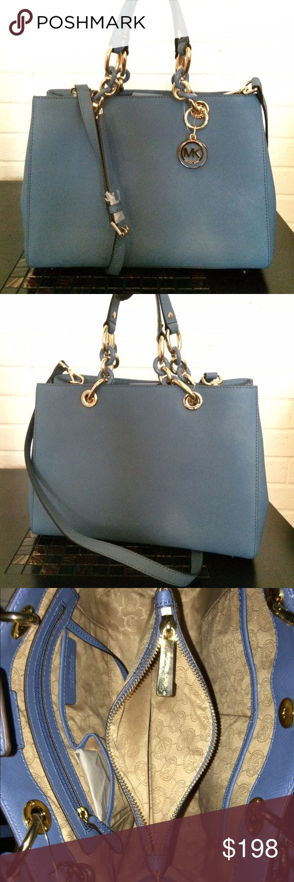 Michael kors Sky blue Cynthia leather tote My prices are lower throughⓂ️ercari and through 🅿️🅿️ Bags are 100% authentic and brand new with tags guaranteed!! Michael Kors Sky blue Cynthia medium satchel tote. Stored in pet free and smoke free home. Serious buyers only please and only comment if it's about purchasing. I will not respond to lowball offers.  customers know my background. Thank you   Measurements medium Michael Kors Bags