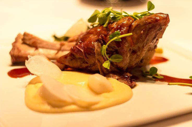 Red Wine Braised Lamb Shank with Rutabaga puree, soppresatta laced collard greens, shaved white turnips, natural jus.
