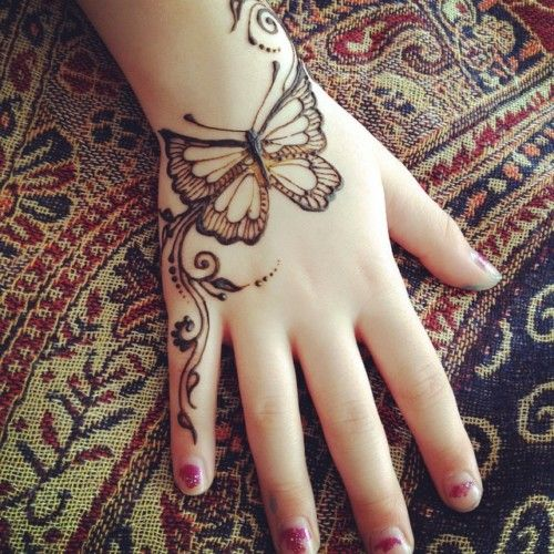 Diagonal simple butterfly mehndi design for back hand